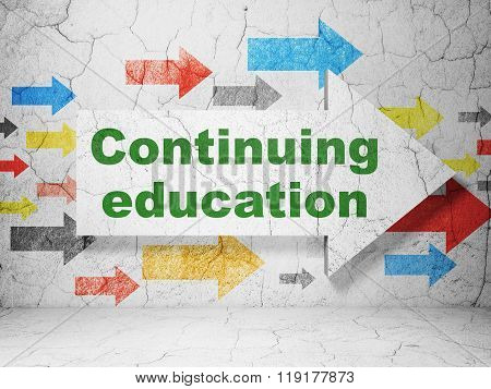 Education concept: arrow with Continuing Education on grunge wall background