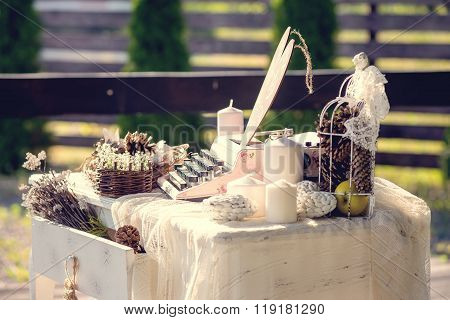 Wedding decoration classic type writer with blank paper , a withered rose and candles