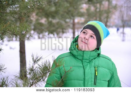 Boy Teenager In  Green Jacket At  Winter Pine Forest