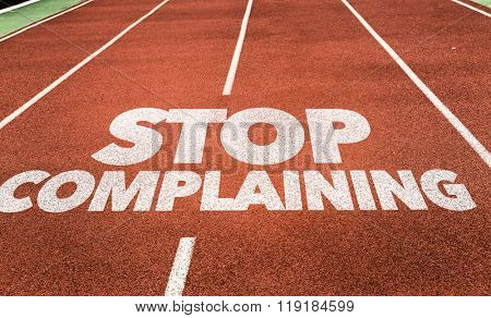 Stop Complaining written on running track