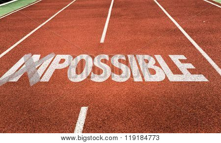 Impossible - Possible written on running track