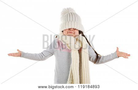 Confused little girl in a trendy knitted clothes, isolated on white