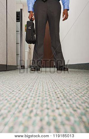 Businessman stood in corridor