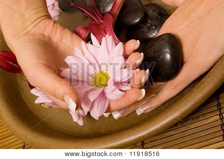 Woman rejuvenating her hands in water