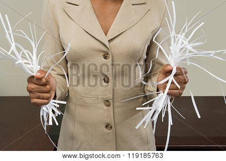 Woman holding shredded paper