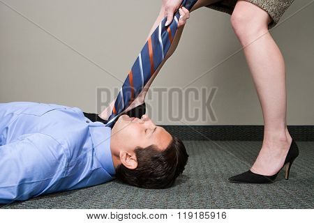 Woman pulling manager's tie