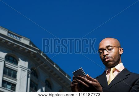 Businessman with handheld computer
