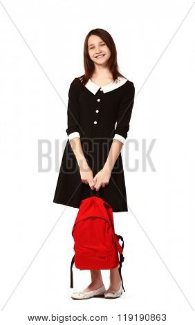 Beautiful schoolgirl with schoolbag isolated on white