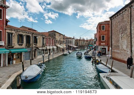 VENICE, ITALY - 17 OCTOBER 2015: Canal and street scene on Murano island in Venice, Italy