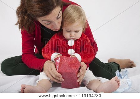 Baby With Mother Opening Christmas Gift