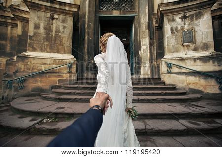 Beautiful Bride Leading Groom To Old Baroque Church