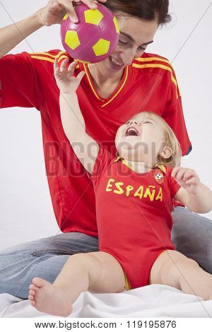 Happy Baby And Mother Spanish Soccer Fans