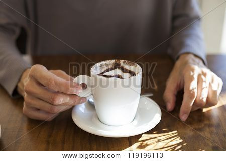 Woman Taking Cappuccino