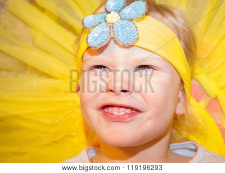 Little girl making funny face in tutu