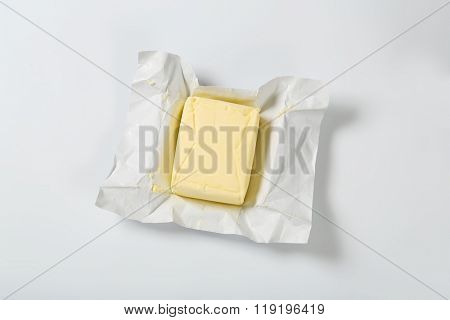 block of fresh butter on white background