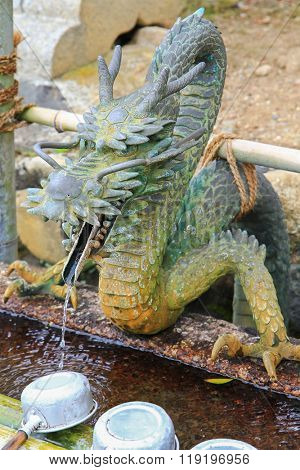 Water running out through Dragonâ??s mouth to water basin at Nigatsu-do Hall, Nara, Japan. It is to purify oneself before visiting shrine in Japan