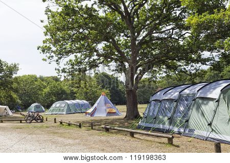 camp ground in woodlands with family tents