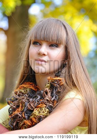 A Portrait Of Young Beautiful Woman Is In An Autumn Park