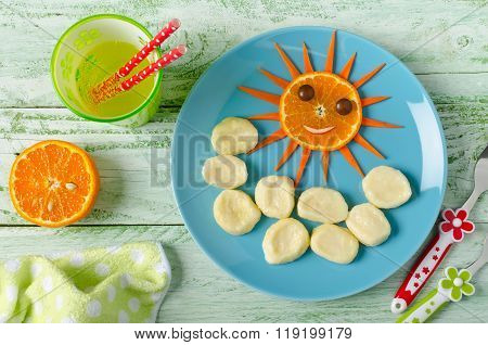 Children Breakfast Lazy Dumplings And Orange In The Shape Of The Funny Face Sun