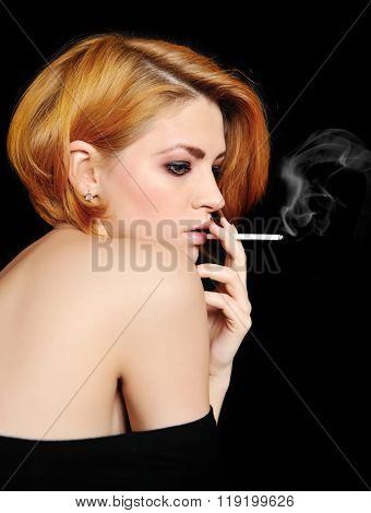 Portrait Of Beautiful Redheaded Girl That Smokes
