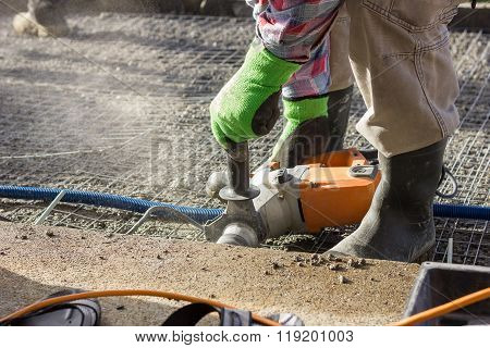 Handyman Using Hammer Drill Outside At The Garden To Drilling Hole