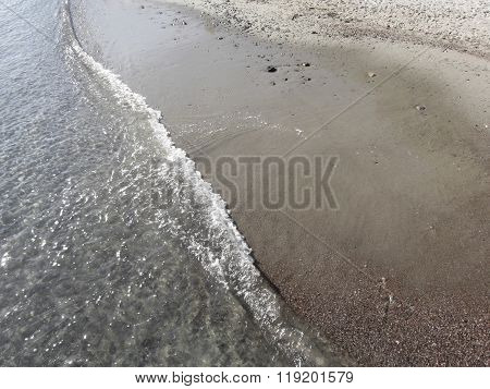 Wave Of The Sea On The Sand Beach. Portovenere, Province Of La Spezia, Italy