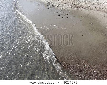 Wave Of The Sea On The Sand Beach. Portovenere, Province Of La Spezia, Italy