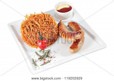 Fried Sausages With Stewed Cabbage On Square Serving Dish, Isolated.