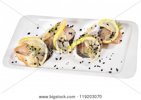 Sliced Bonito Cold Smoked With Lemon Slices On Rectangular Plate.