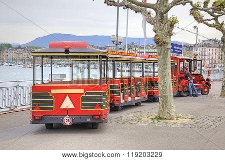 Geneva. Children Road Train Ashore Lake