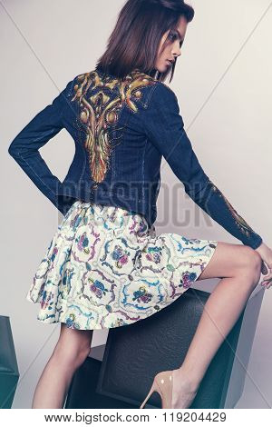 Woman in denim jacket and skirt