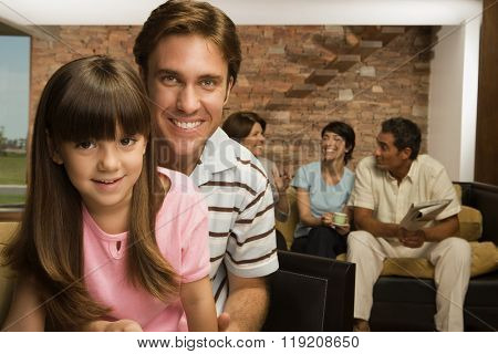Girl and father with family