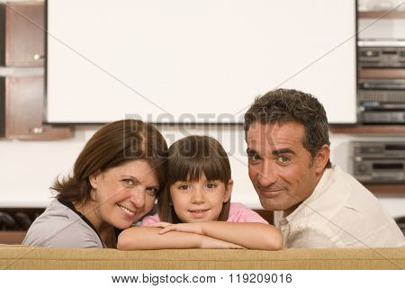 Girl and grandparents in living room