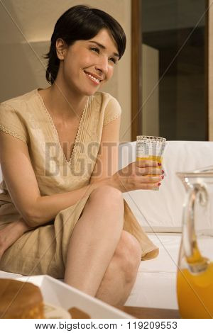 Woman with glass of orange juice