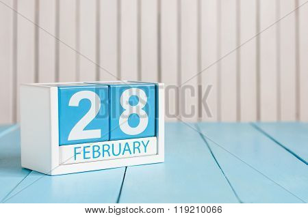 February 28th. Cube calendar for february 28 on wooden surface with empty space For text. Leap year,