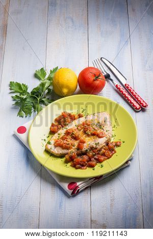 swordfish with fresh tomatoes and grated lemon peel