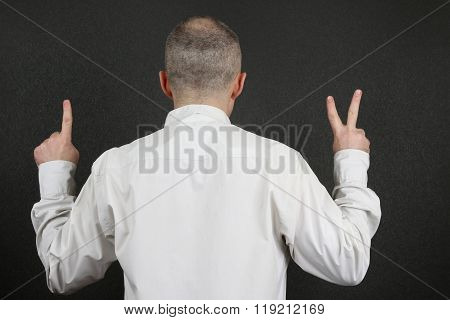 Standing Back, The Man Hands Shows The Signs Of 1 And 2