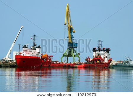 Red motorboat to oil  industry
