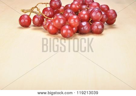 Delicious Bunch Red Seedless Crimson Grape On Wood Plank