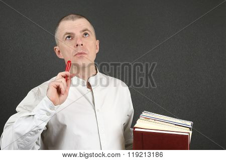White Man With A Pen And Books In Their Hands Looking To The Top