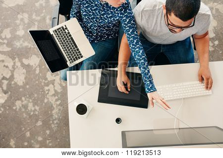 Young Graphic Designers Coworking In Office