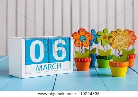 March 6th. Image of march 6 wooden color calendar with flower on white background.  First spring day
