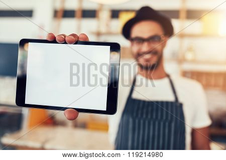Digital Tablet In Hand Of Cafe Owner