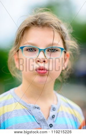 Girl In Eyeglasses With Disheveled Hair