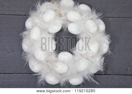 White Wreath With White Eggs On Dark Wooden Background