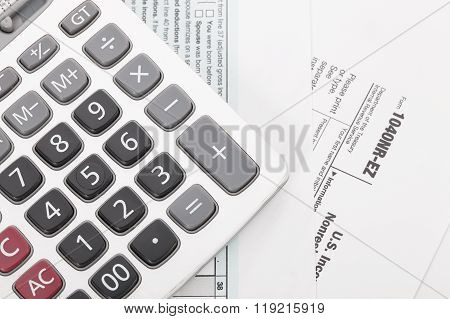 Calculator On Tax Form Background