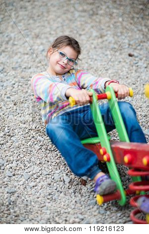 Funny Girl In Eyeglasses Playing At Playground