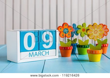 March 9th. Image of march 9 wooden color calendar with flower on white background.  Nineth spring da