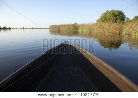 Mokoro floating through the Okavango Delta, Botswana