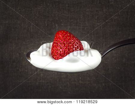 Strawberries In White Cream On A Silver Spoon